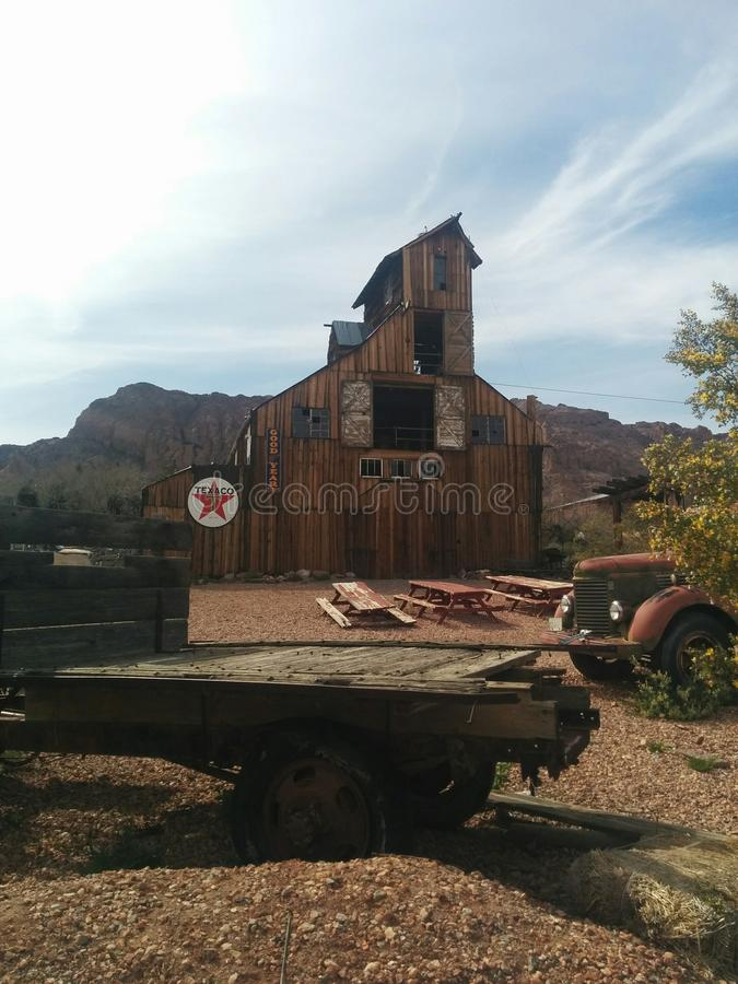 Distant view of huge multi-story wooden barn in desert stock photography