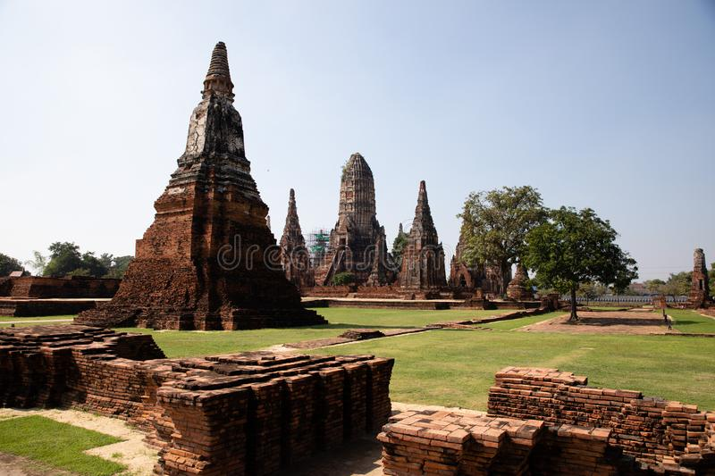 Distant views of the Ayutthaya ruin temple with sunlight and green grass. With copy space stock image