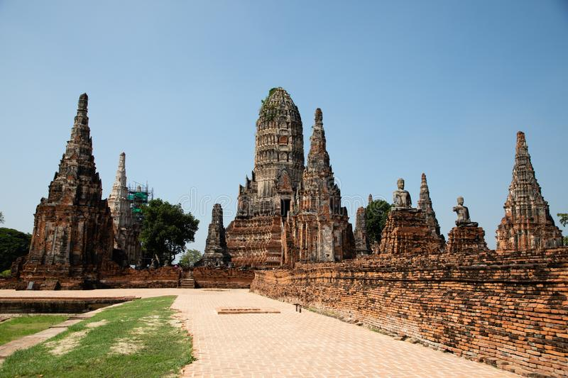 Distant views of the Ayutthaya ruin temple with sunlight and green grass. With copy space stock photo