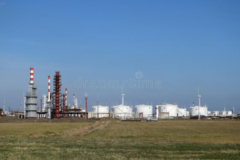 Distillation columns, pipes and other equipment furnaces refinery. The oil refinery. Equipment for primary oil refining stock image