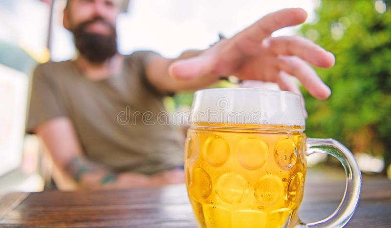 Distinct beer culture. Mug cold fresh beer on table close up. Man sit cafe terrace enjoying beer defocused. Alcohol and. Bar concept. Creative young brewer stock image
