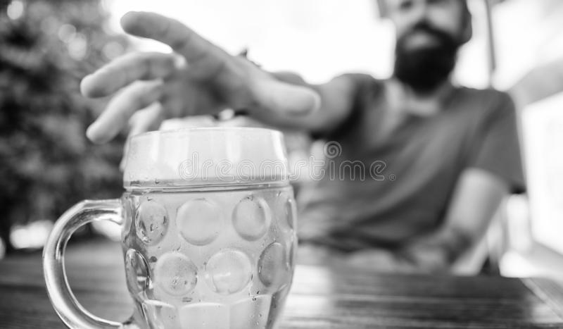Distinct beer culture. Mug cold fresh beer on table close up. Man sit cafe terrace enjoying beer defocused. Alcohol and. Bar concept. Creative young brewer stock photo