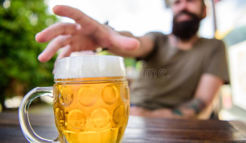 Distinct beer culture. Mug cold fresh beer on table close up. Man sit cafe terrace enjoying beer defocused. Alcohol and. Bar concept. Creative young brewer stock photography