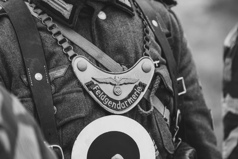 Distintivo con l'iscrizione - polizia militare Truppe tedesche immagine stock