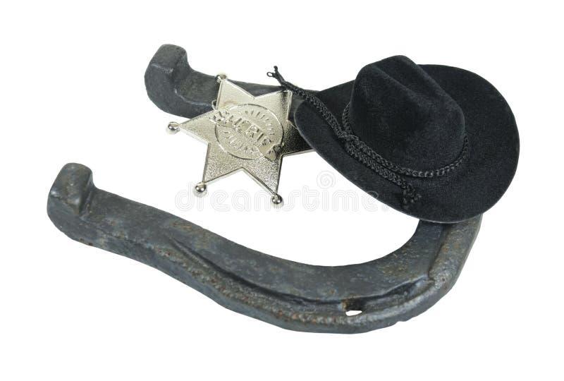 Distintivo dello sceriffo e cappello a ferro di cavallo del cowboy immagine stock