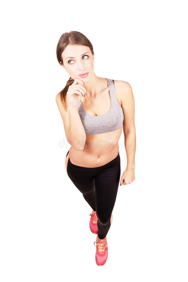 Distogliere lo sguardo sicuro della donna di giovane misura sportiva fotografia stock