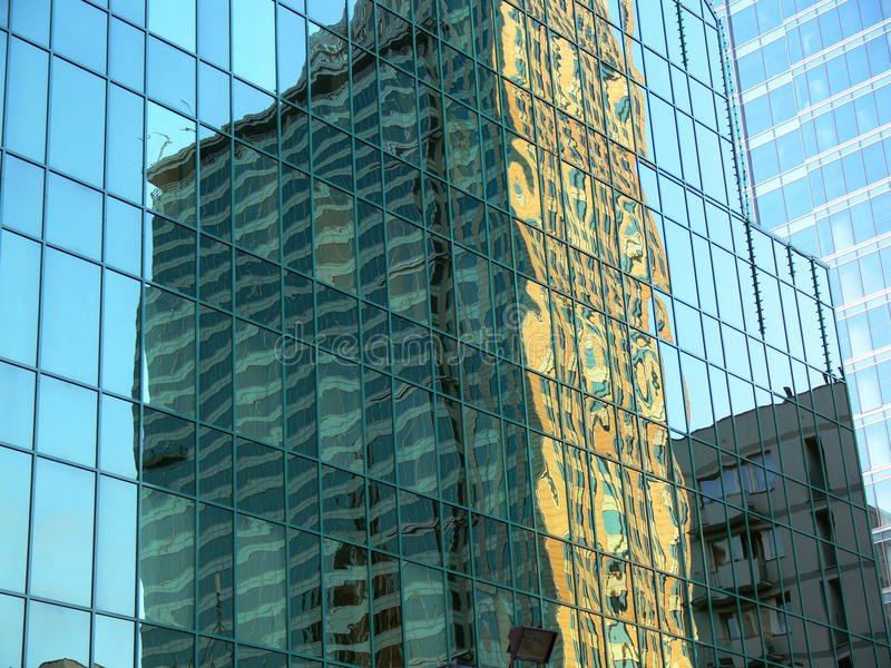 Distorted reflection of a building stock photos