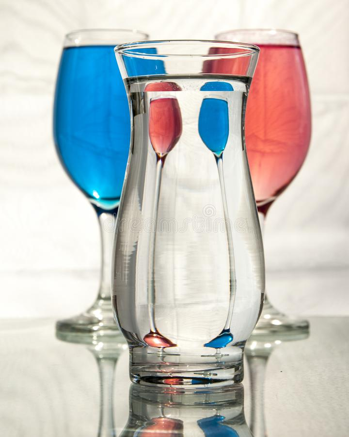 Distortion and refraction in three glasses of water stock photos