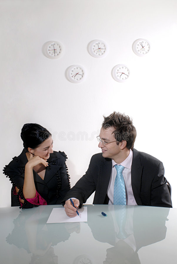 Distracted business couple stock images