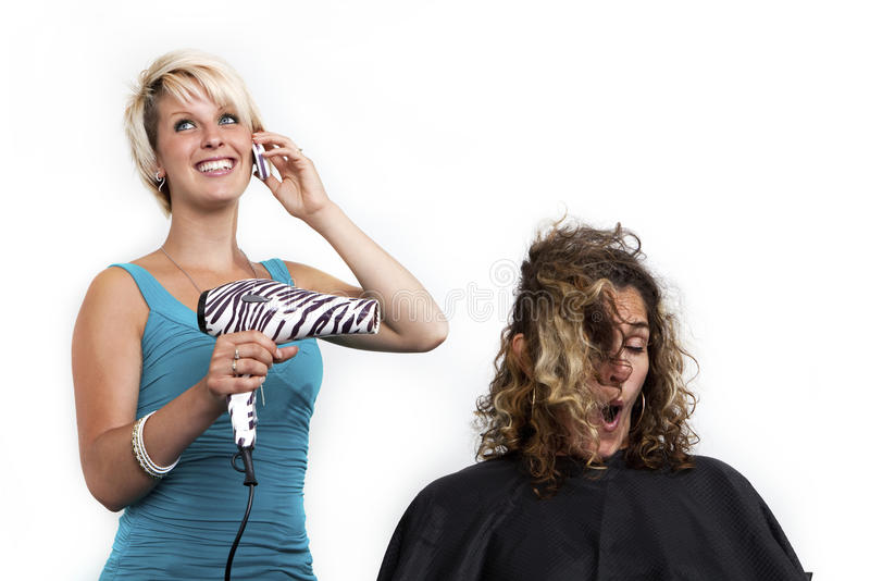 Distracted hairdresser stock photo