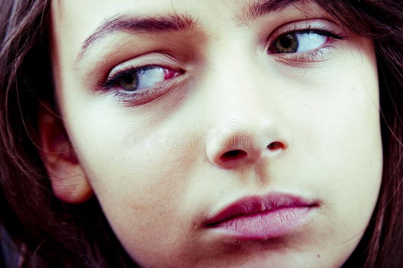 Distracted Teen. Closeup portrait of a distracted teenage girl, averting her eyes. Horizontal format stock photos