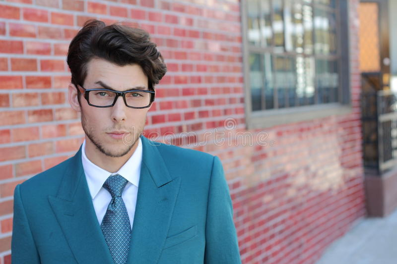 Distraught young businessman with raised eyebrow on the street royalty free stock photography