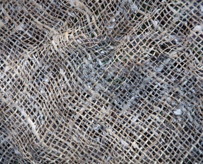 Distress grunge texture of fabric, bag, sack, sac, sackcloth, bagging, sacking stock image