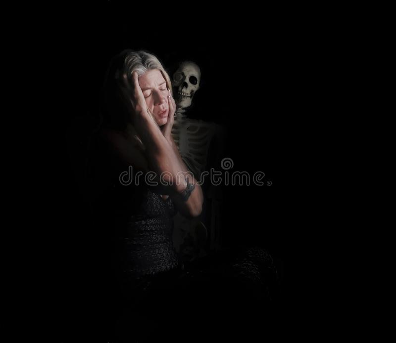 Woman and skull stock image