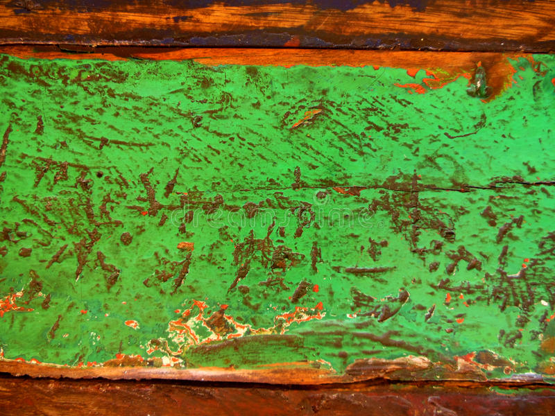 Distressed Green Paint. Detail of aged green paint on old wood royalty free stock photo