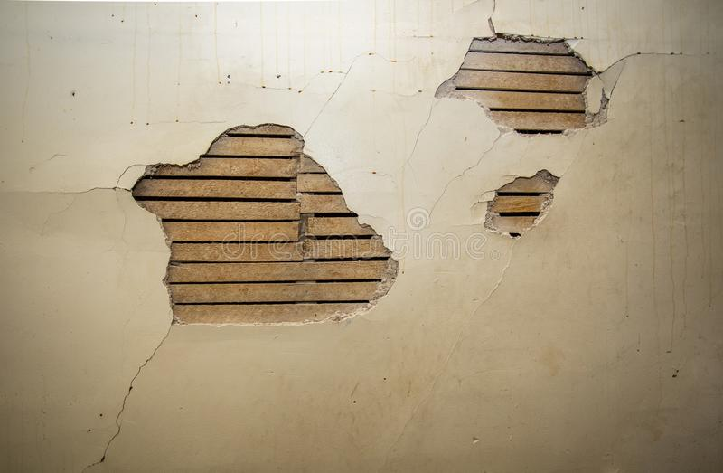 Distressed Plaster and Wood Lath royalty free stock photography