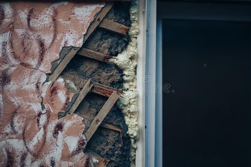 Distressed wall with holes in plaster and wood lath.  royalty free stock photos