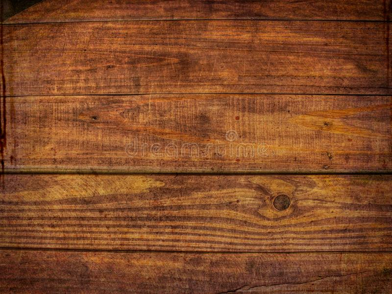 Distressed Wood Texture Background - Brown Grunge Wood Floor or Desk Surface royalty free stock photos