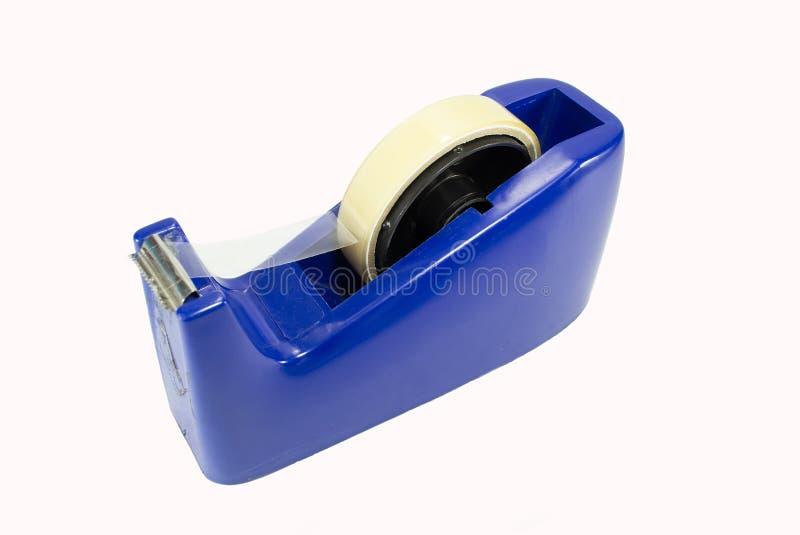 Distribuidor azul da fita no fundo branco fotografia de stock