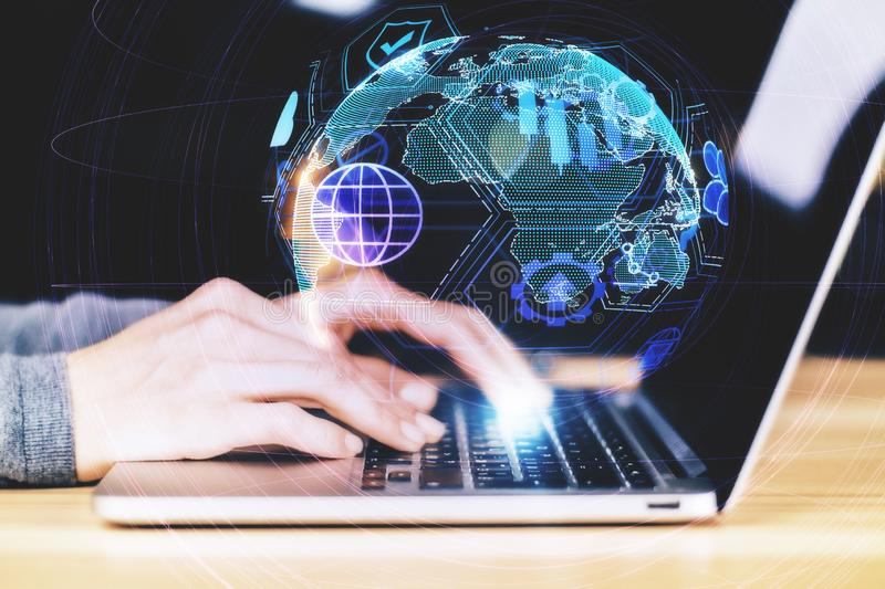Distributed data and communication concept. Close up and side view of hands using laptop with digital globe interface on blurry background. Distributed data and stock photography