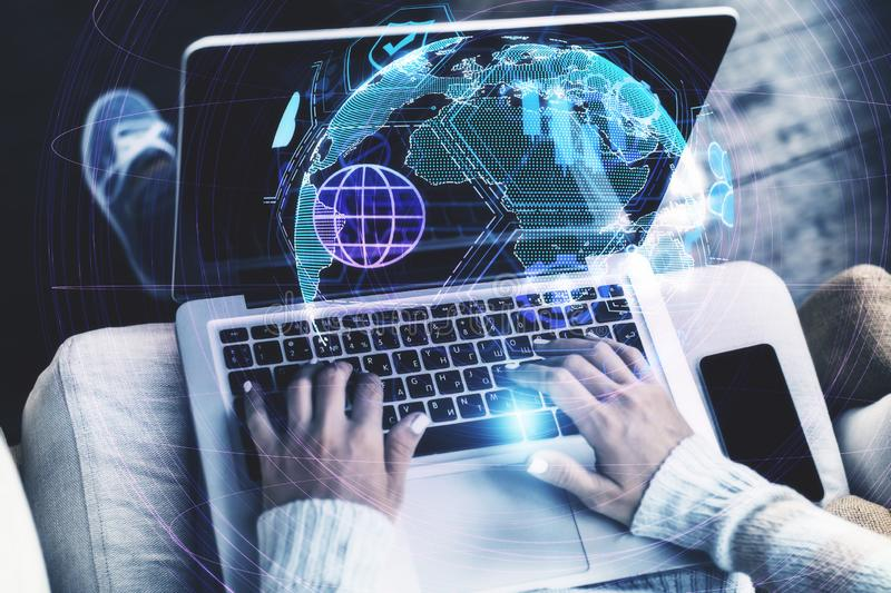 Distributed data and map concept. Close up of hands using laptop with digital globe interface on blurry background. Distributed data and map concept. Double royalty free stock photography