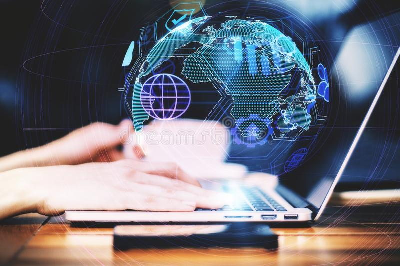 Distributed data and network concept. Close up and side view of hands using laptop with digital globe interface on blurry background. Distributed data and stock photo