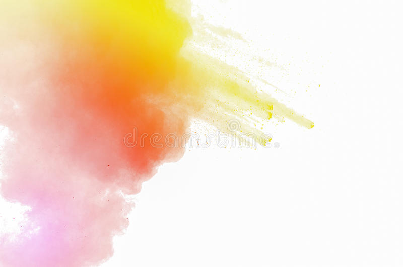 Distributed powder. Abstract art powder paint on white background. Movement abstract frozen dust explosion multicolored on white background. Stop the movement of royalty free stock image