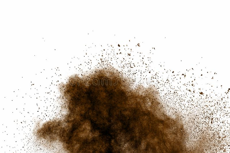 Distributed powder. Explosion of brown dust on white background royalty free stock photography