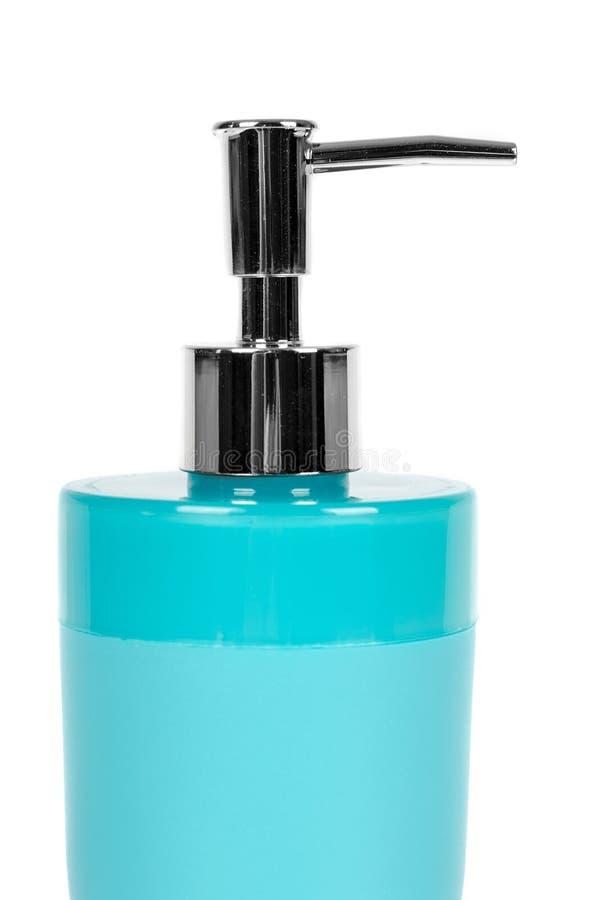 Distributeur bleu de savon d'aseptisant de main d'isolement sur le fond blanc photos libres de droits