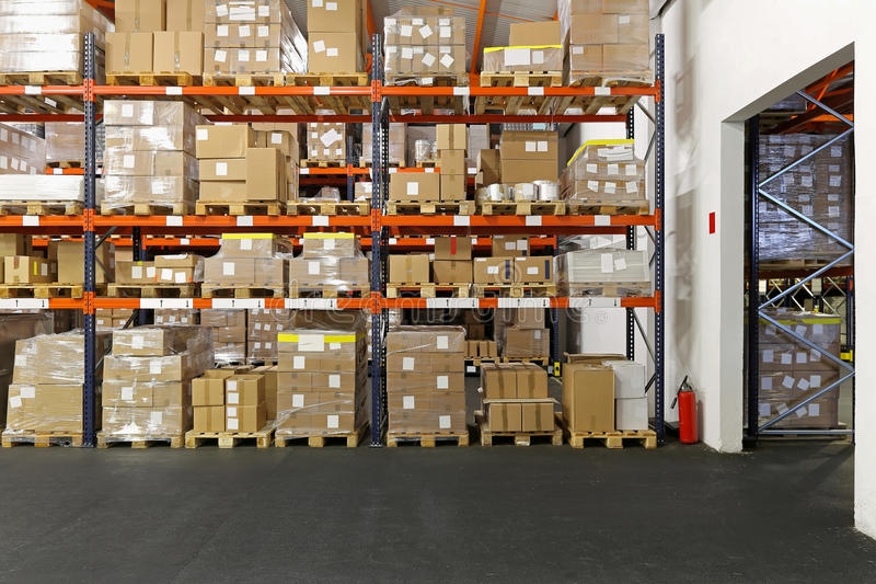 Distribution center. Boxes and crates at shelves in distribution warehouse stock photography