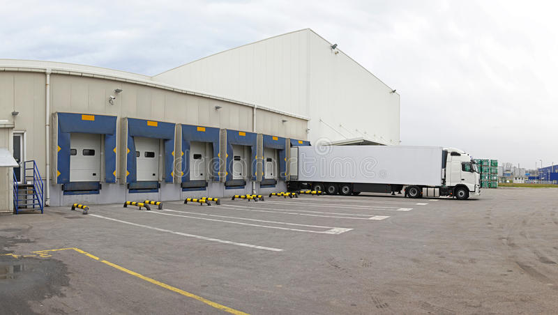 Distribution center. Distribution warehouse exteriopr with logistics center stock image