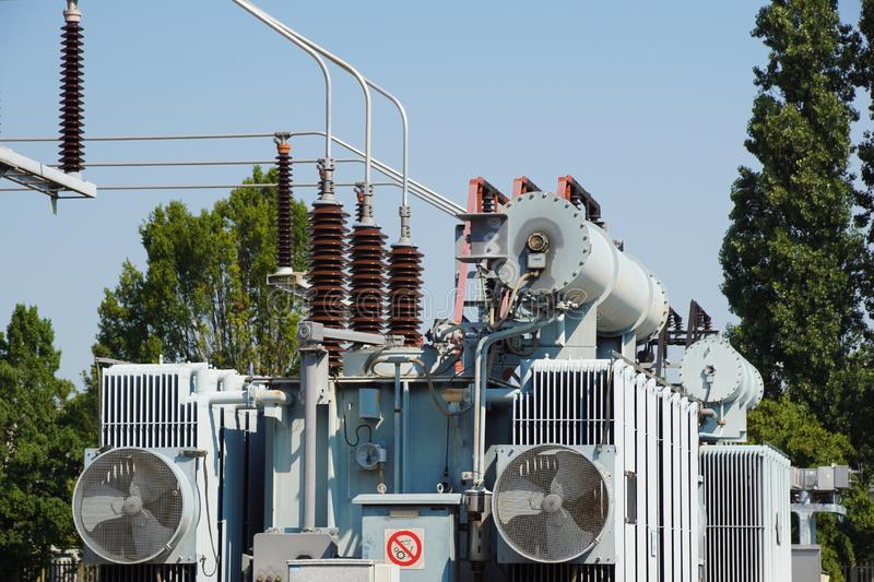 Distribution electric substation with power lines and transformers stock photos
