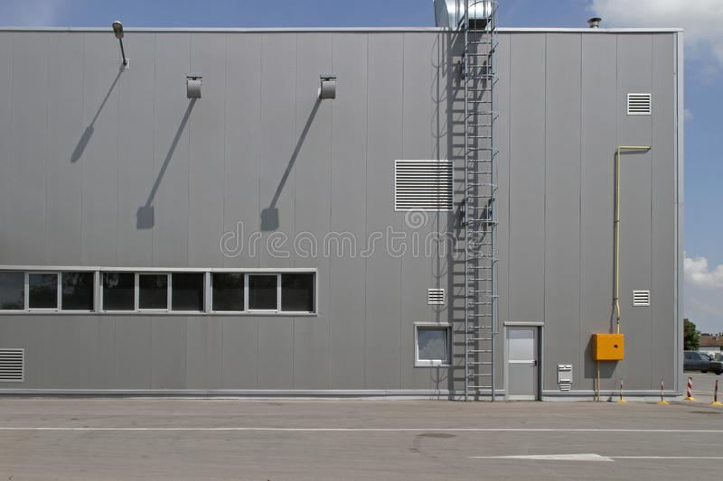 Warehouse Exterior. Distribution Warehouse Building Exterior With Safety Ladder royalty free stock photography