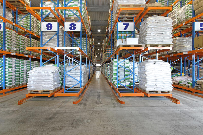 Warehouse shelving system. Distribution warehouse shelving system with sacks and bags stock photography