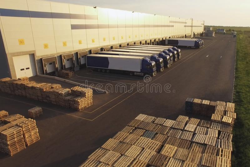 Distribution warehouse with trucks of different capacity stock image