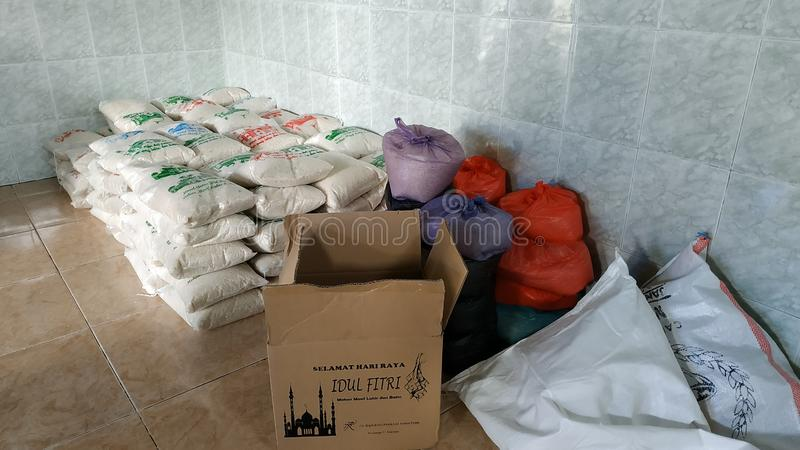 Zakat Fitrah ahead of Eid al-Fitr for the poor stock images