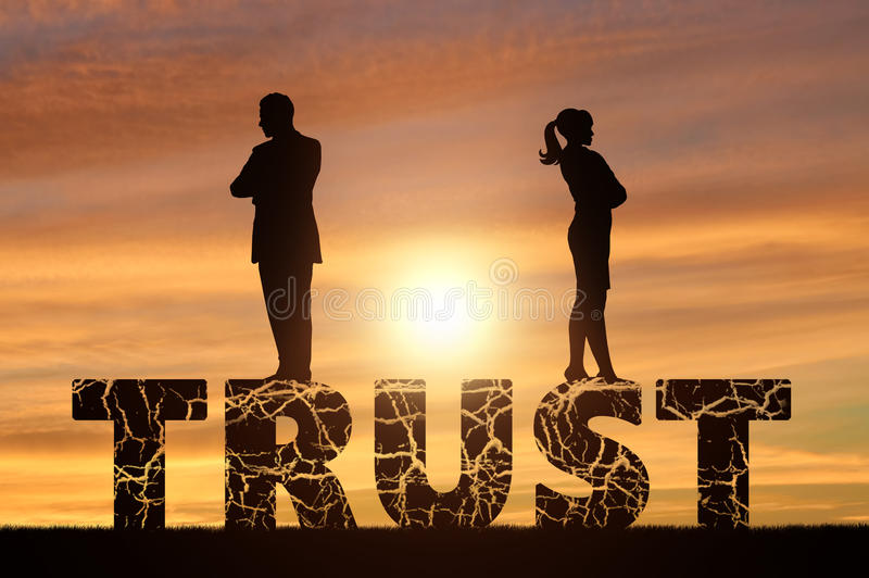 Distrust and betrayal in the family. Wife and husband are on a cracked word of trust stock photography