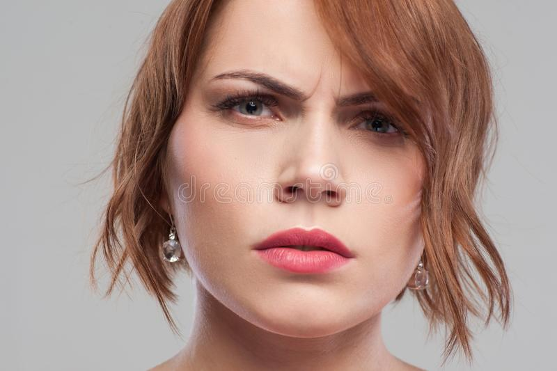 Distrust in partner. Suspicious look. Relationships problems, angry female portrait on grey background closeup, suspicion concept stock photos