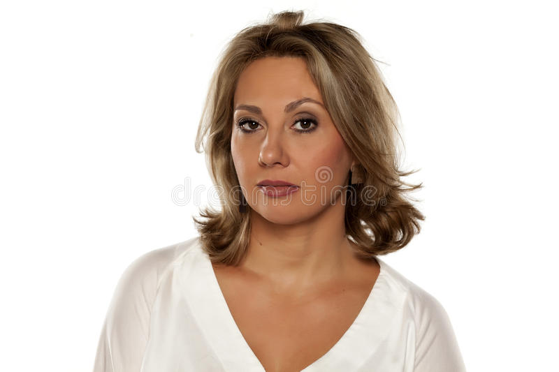 Distrustful woman. Beautiful middle-aged woman looking with distrust stock image