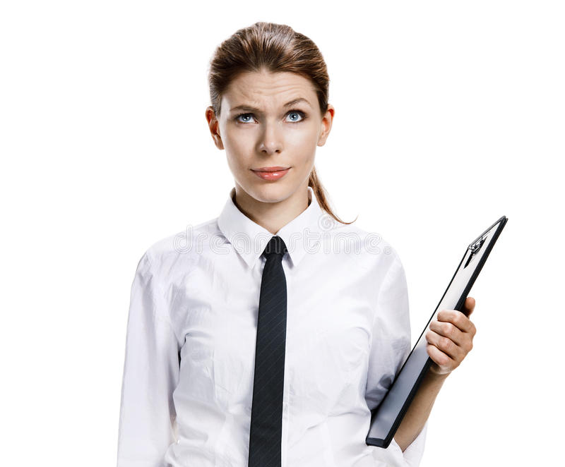 Disturbance, indignation, perturbation. Studio photo of confused girl in a white shirt clipboard and pen - isolated on white background stock photos