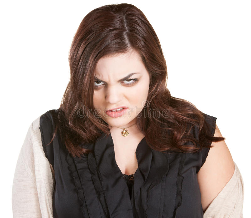 Angry Woman in Sweater. Disturbed Caucasian female in white sweater on isolated background stock photos