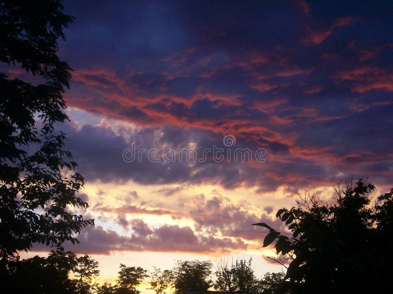 A disturbing sunset in romania east. In a summer day with differents colours stock image