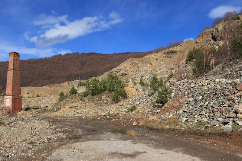 Disused Bulgarian stone quarry. Abandoned Bulgarian stone quarry in Vrachanski Balkan Mountains, near Vratsa. Sunny day royalty free stock photography