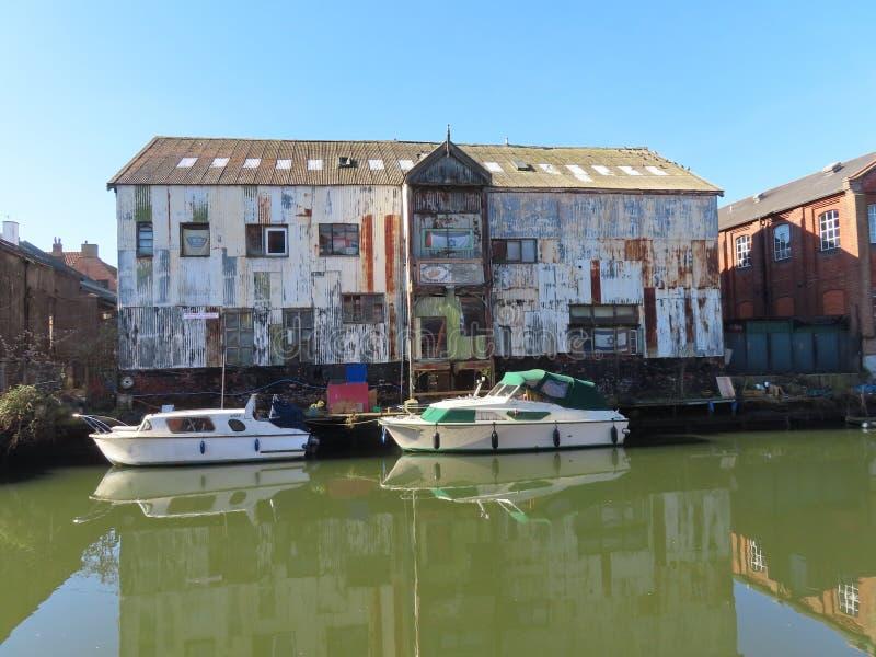 Disused Warehouse in Norwich. A scruffy near derelict warehouse along the river Yare in Norwich stock photo