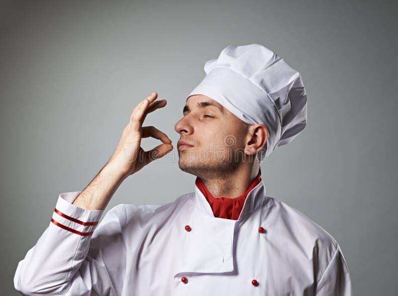 Dita bacianti del cuoco unico maschio fotografie stock libere da diritti