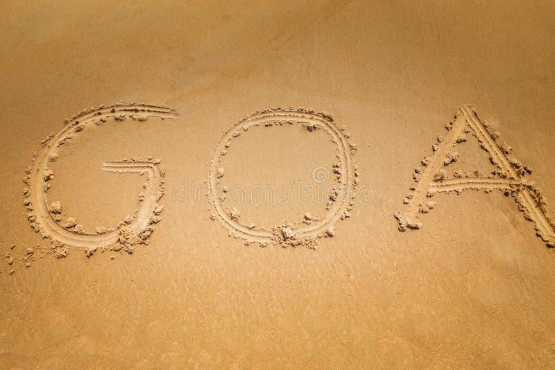Dito attinto la parola Goa della sabbia immagine stock