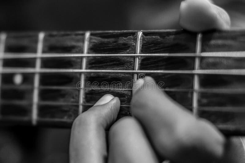 Dito della chitarra fotografie stock