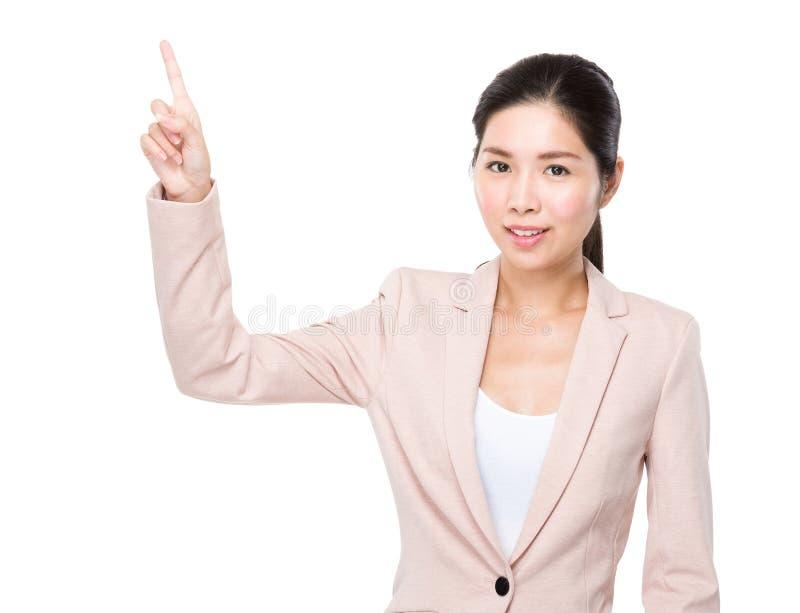 Dito della donna di affari su fotografia stock