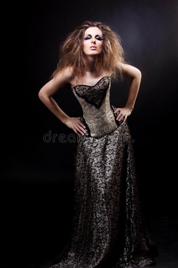 Diva. Young beautiful girl in a long dress with a corset stock image