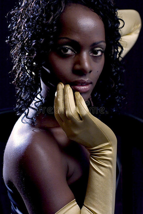 Diva, The woman with golden gloves. The woman with golden gloves royalty free stock photos